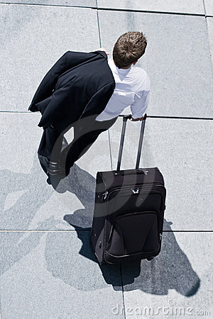 Corporate Man With Rolling Luggage