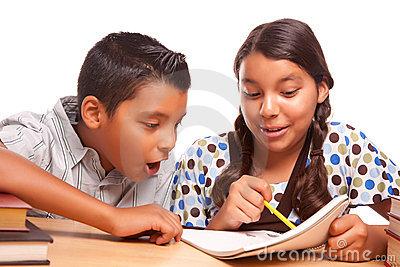 Hispanic Brother and Sister Having Fun Studying