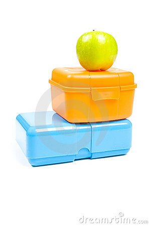 Colorful lunchboxes with green apple