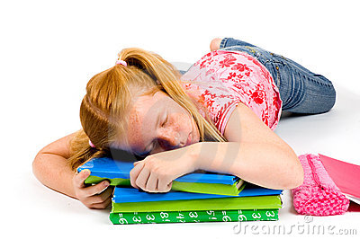 Child sleeping while working on homework