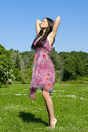Brunette on the meadow