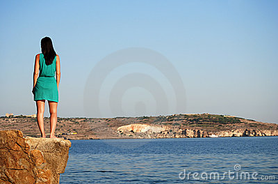 Standing on cliff