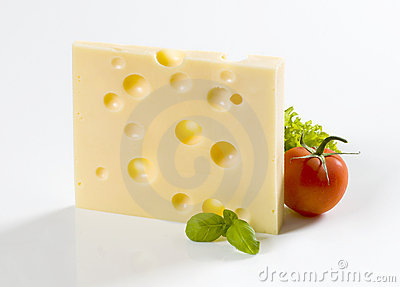 Slice of hard cheese and a tomato
