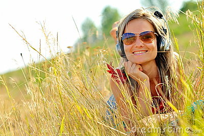 Portrait of beautiful happy woman listening to mus
