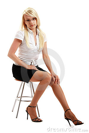 A young attractive woman sitting on stool