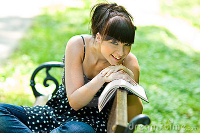 Happy girl with book