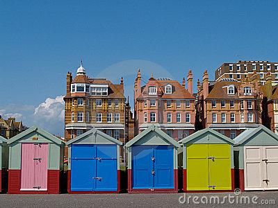 Five Beach huts infront of traditional Hove buildings