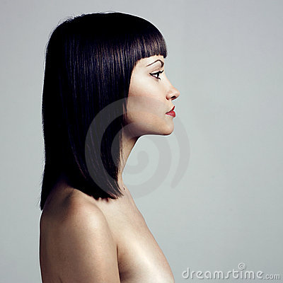 Profile of woman with strict hairstyle