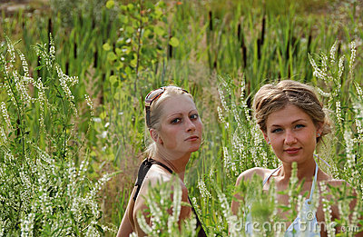 Girls between high grass