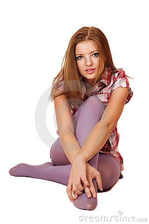 Cute young blond girl sitting on the floor