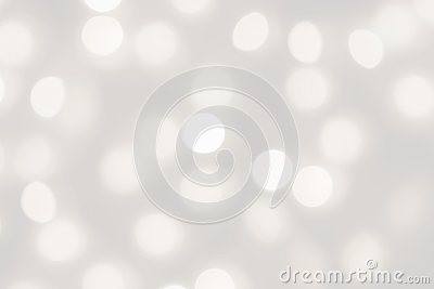 White lights bokeh blurred background, abstract beautiful blurry silver Christmas holiday party texture, copy space