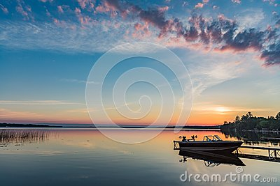 Cottage Lake Sunrise with Boat at Dock in Kawartha Lakes Ontario Canada