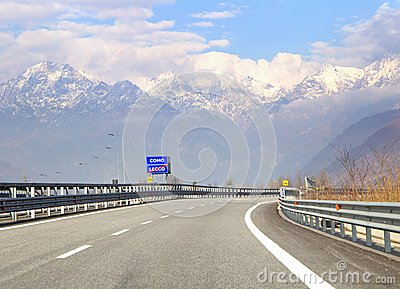 Road sign with indication to go lake Como in Italy. Traffic on hihgway in the Italian Alps