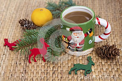 Winter coffee in a christmas mug with christmas deers