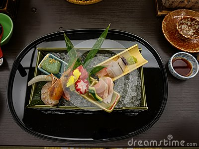 Japanese ryokan kaiseki dinner decorative sashimi set including Pacific blue fin tuna, shrimp, greater amberjack, halfbeak