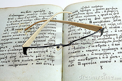 Glasses on old books
