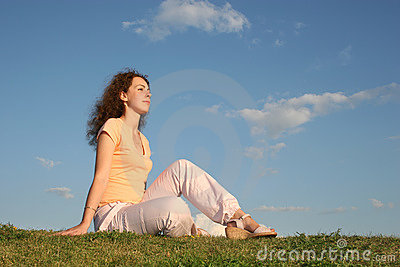 Woman on grass sunset