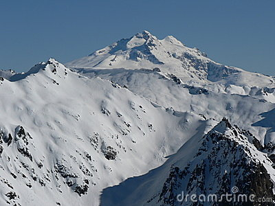 Snow-covered Mountain top in sunshine