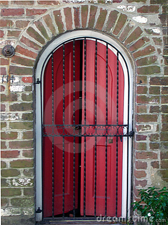 Red Door behind Iron Gate