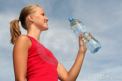 Woman with bottle of mineral water