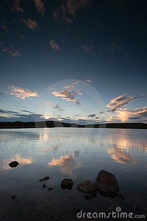 Sunset reflected in remote loch in Scotland
