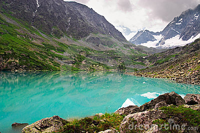 Turquoise lake and mountains.