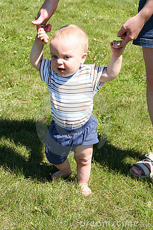 Boy learning to walk
