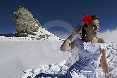 Bride with red flower in hair.