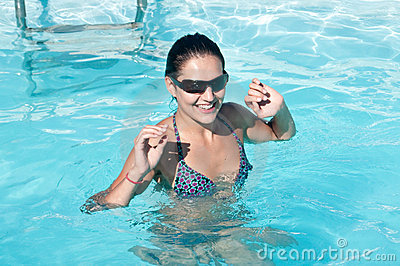 Woman with sunglasses in pool