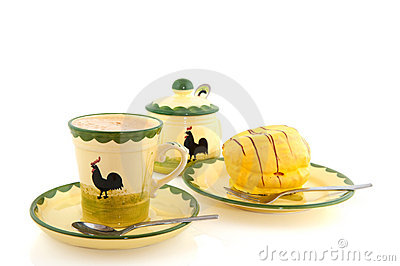 Cup of coffee with yellow cakes