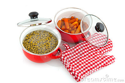 Red pans with vegetables
