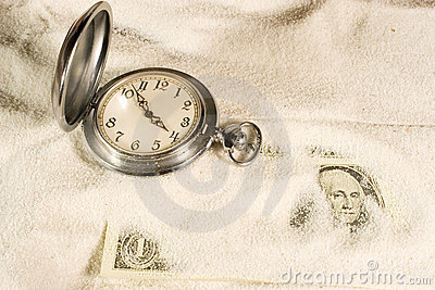 Pocket watch and US dollars