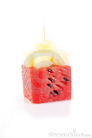 Watermelon cube with bits of pineapple