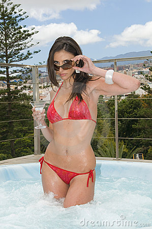 woman having a drink in outdoor jacuzzi