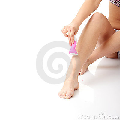 Woman depilating her legs