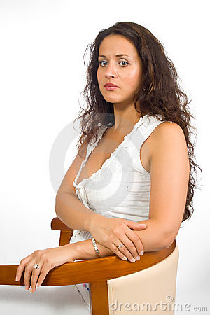 Woman in blouse on a chair