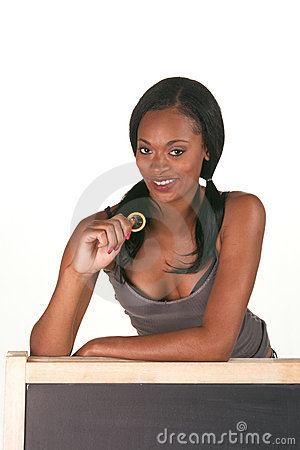 African-American woman with condom by blackboard