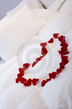 Romantic bed with heart of roses