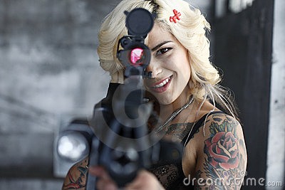 Stylish woman aiming assault gun