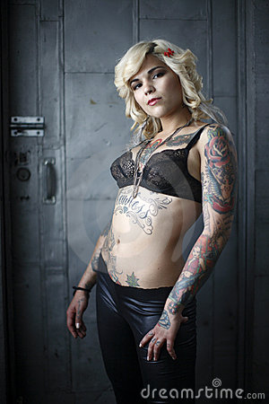 Stylish woman with tattoos