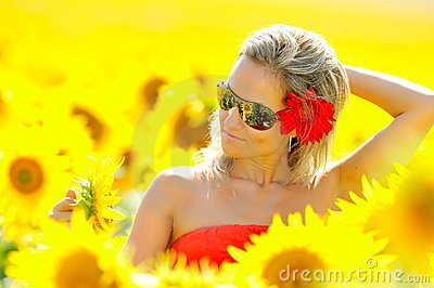 Young woman between sunflowers
