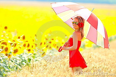 Young woman on sunflower field