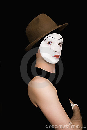 Mime in a hat on a black background