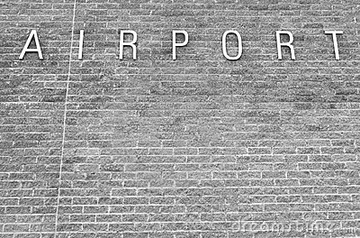 Airport sign on a brick background
