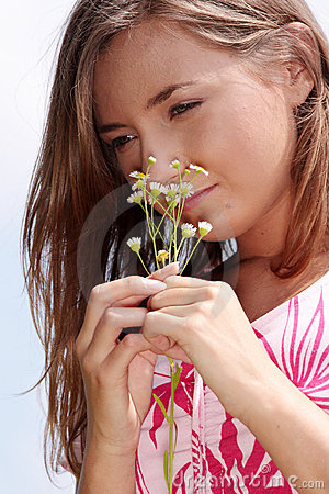 Young girl in blooming meadow