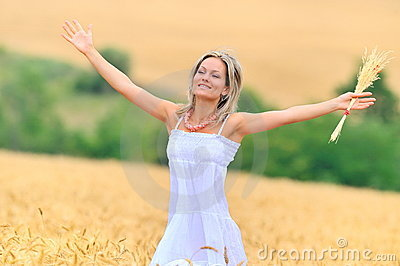 Beautiful woman in golden wheat field