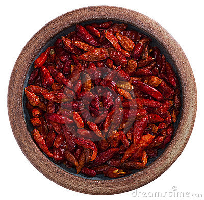 Red hot chilies pepper in pottery bowl, isolated