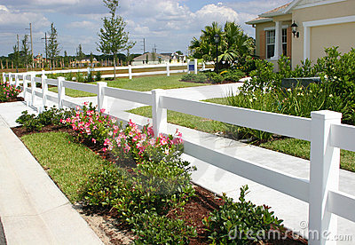 White security fence and flowers