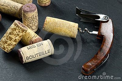 Corks and opener on slate