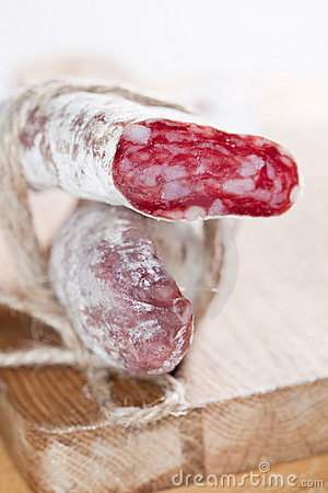Spanish fuet salami cuts tied by string